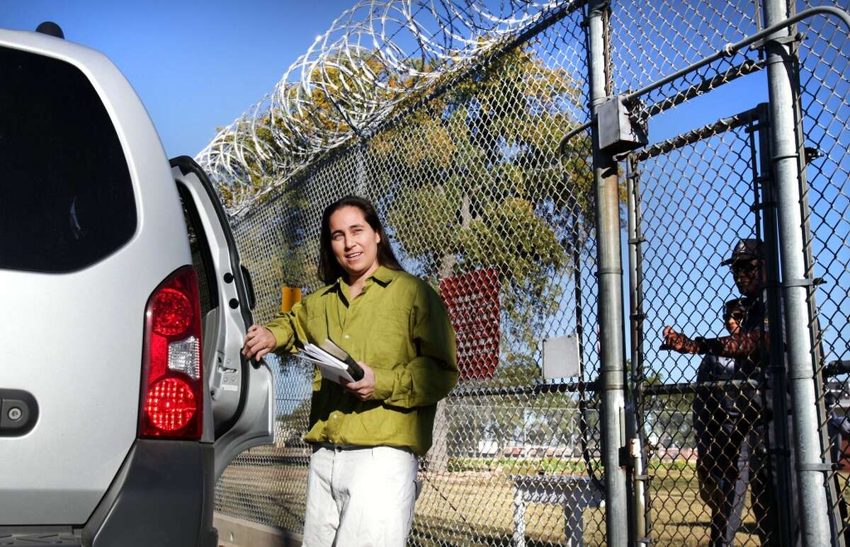 Anna Vasquez opens the door to a relative's car as prison guards at the Crain Unit in Gatesville close the prison gate behind her as she is released on parole after serving 12 and a half years. Vasquez is one of the four San Antonio women fighting to clear their names in the 1994 sexual assault of two sisters. Friday, Nov. 2, 2012. (Photo by Bob Owen/Express-News)