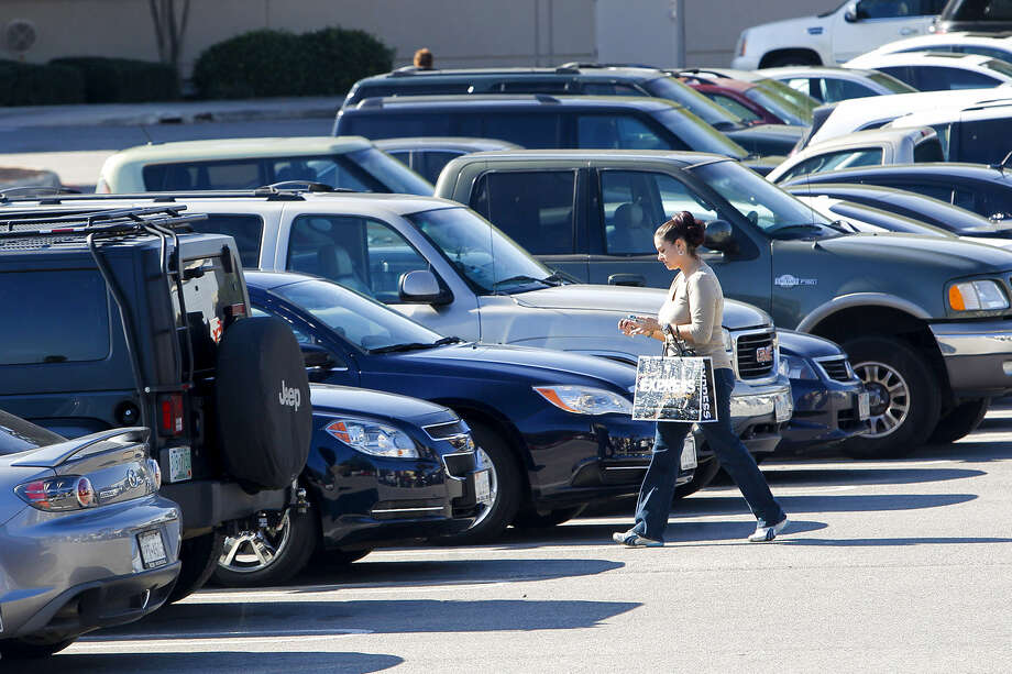 So far in 2014, 16 children have died from heatstroke after being left in a vehicle. Pictured, a shopper returns to her car in a San Antonio mall parking lot Monday. Photo: Marvin Pfeiffer / Southside Reporter