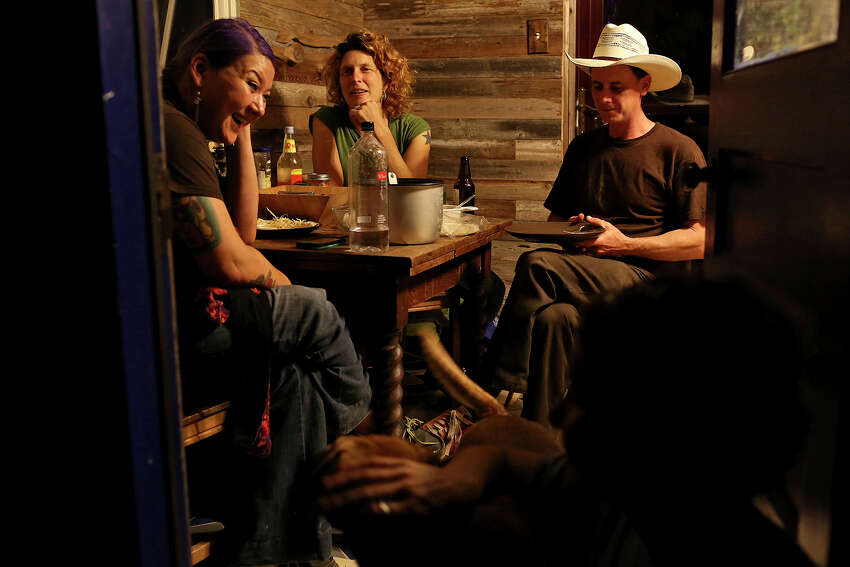 Founding directors and husband and wife, Shane Heinemeier, right, and Alison Heinemeier, center, relax after dinner with outreach coordinator Christina Lee Shane, left, and artist-in-residence Laura Napier at Habitable Spaces in Kingsbury on Thursday, Nov. 21, 2013.