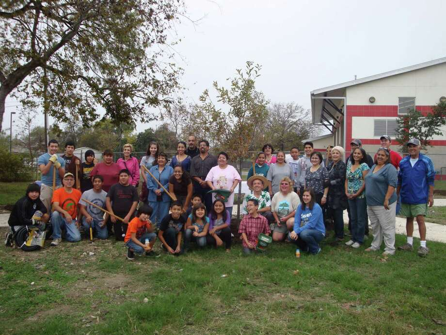 Residents from South San Antonio gather for a group photo after they worked on the new South San Walking Trail at the intersection of New Laredo Highway and Kelsey Avenue. The area is like a small park. Photo: Courtesy Photo