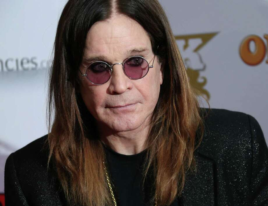 British musicians Ozzy Osbourne of Black Sabbath, arrives at the Classic Rock Roll of Honour awards 2013 at the Camden Roundhouse in north London, Thursday, Nov. 14, 2013. (Photo by Joel Ryan/Invision/AP)  ORG XMIT: JRLON113 Photo: Joel Ryan / Invision
