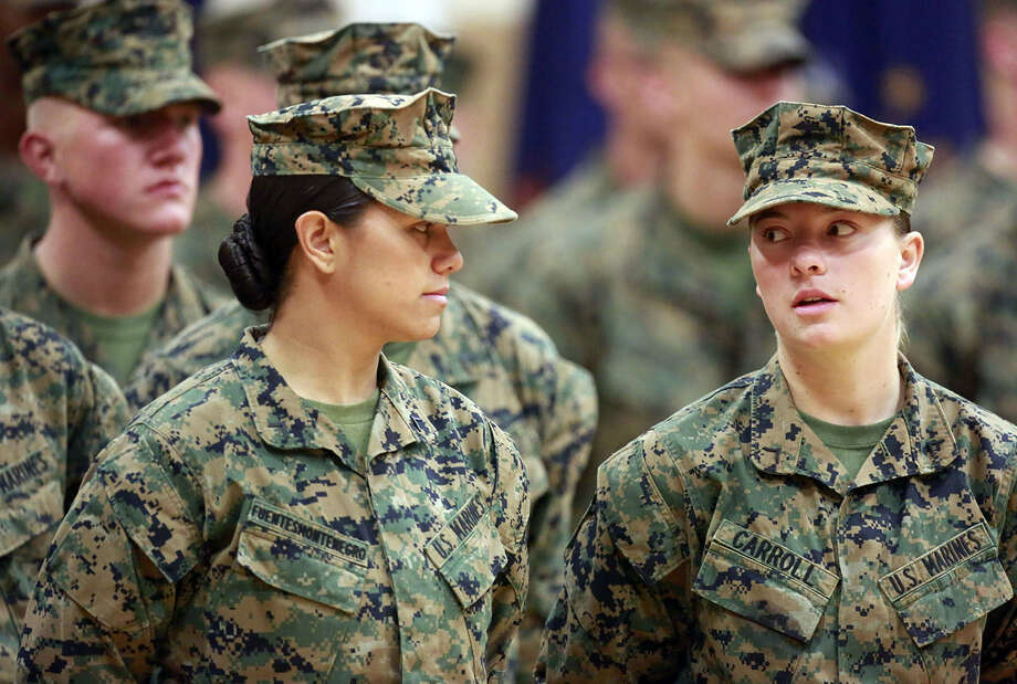 Pfc. Cristina Fuentes Montenegro (left) and Pfc. Julia Carroll graduated from the Corps' enlisted infantry training. A reader hopes future female service members will be held to the same physical standards as males. Photo: John Althouse / Associated Press