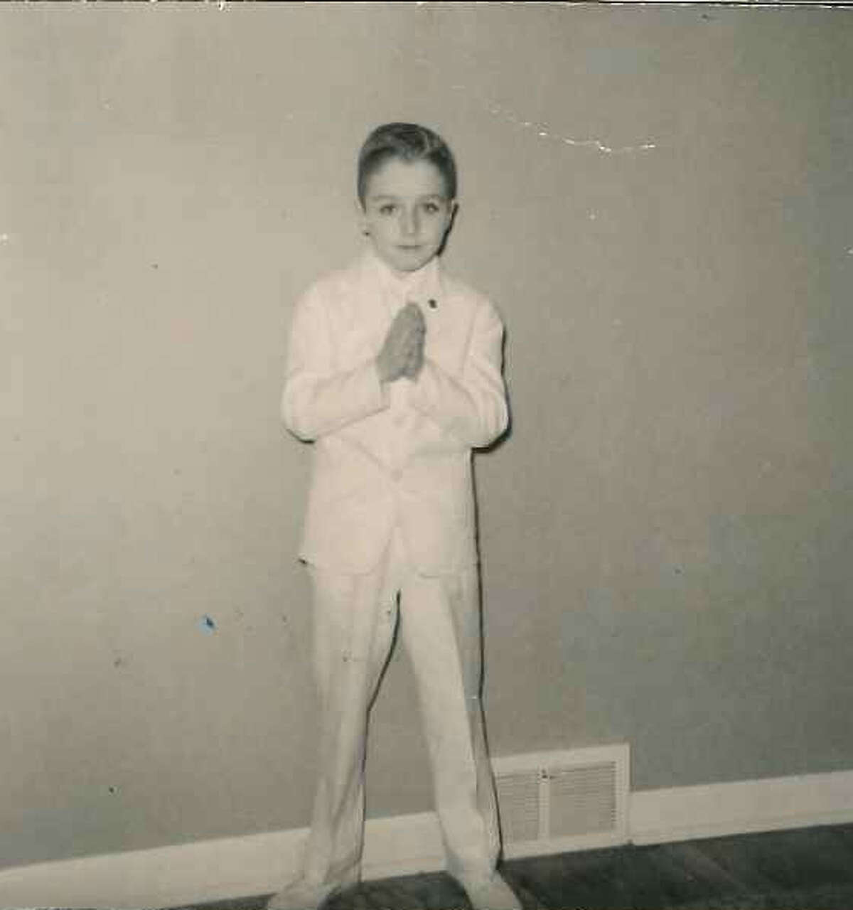 Joe Wenke's first communion in Philadelphia, where he was the oldest of 11 children in a strict Catholic household. The Stamford writer's latest book,