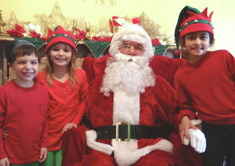 "A visit with the jolly elf himself was a treat for these little elves at the annual ""A Visit to Santa's House"" last year. From left: Ethan Dworski, 4, Charlotte Dworski, 9, and Sophia Mughal, 9. Photo: Staff Photos, Staff Photo / Fairfield Citizen"