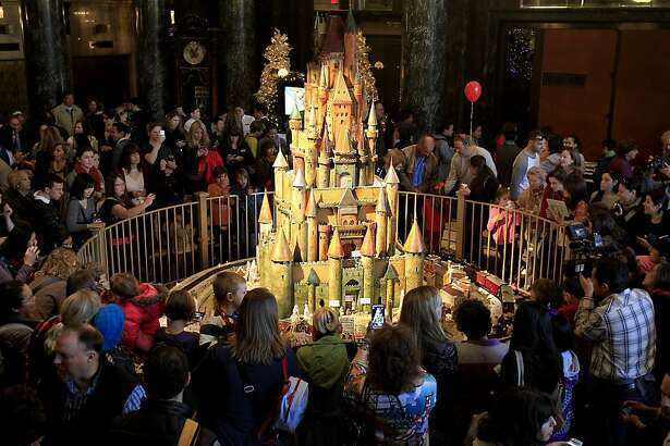 Hotel guests and others gather in the lobby to admire the 2013 version of the sugar castle Thursday November 27, 2013 in San Francisco, Calif. The Westin St. Francis hotel at Union Square unveils a beautiful sugar castle every year designed by executive pastry chef Jean Francois Houdre.