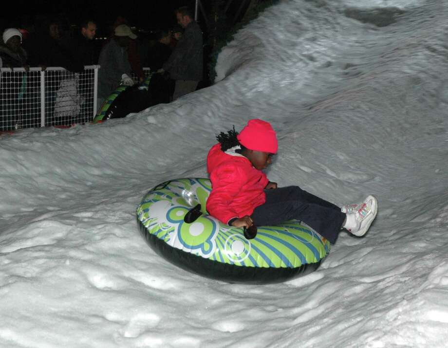 Courtney Pinney takes a ride at the Snowfest Festival in Missouri City. Photo: George Wong / Freelance
