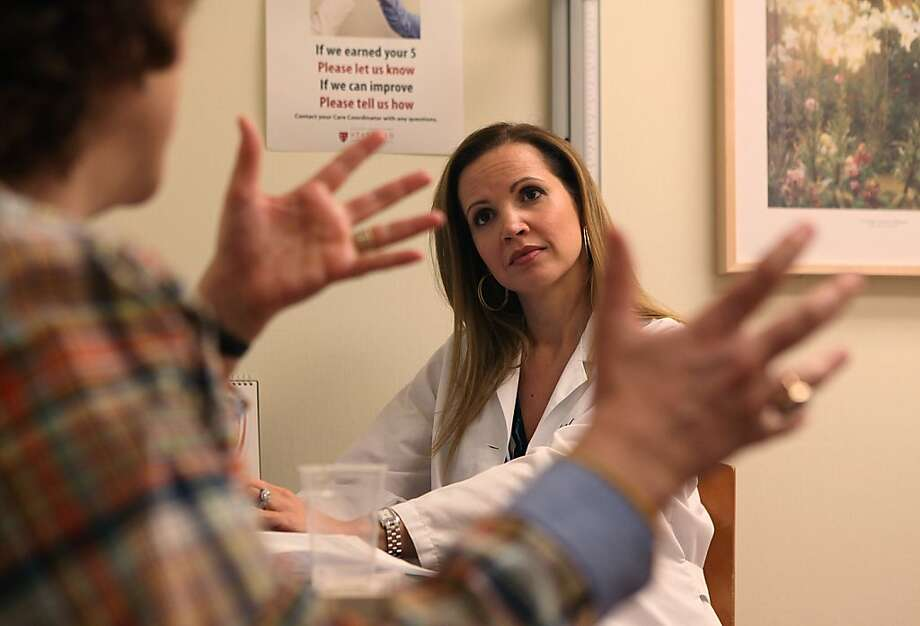 Gynecologist Dr. Leah Millheiser, with a new patient, started Stanford's Female Sexual Medicine Program in 2008. Photo: Liz Hafalia, The Chronicle