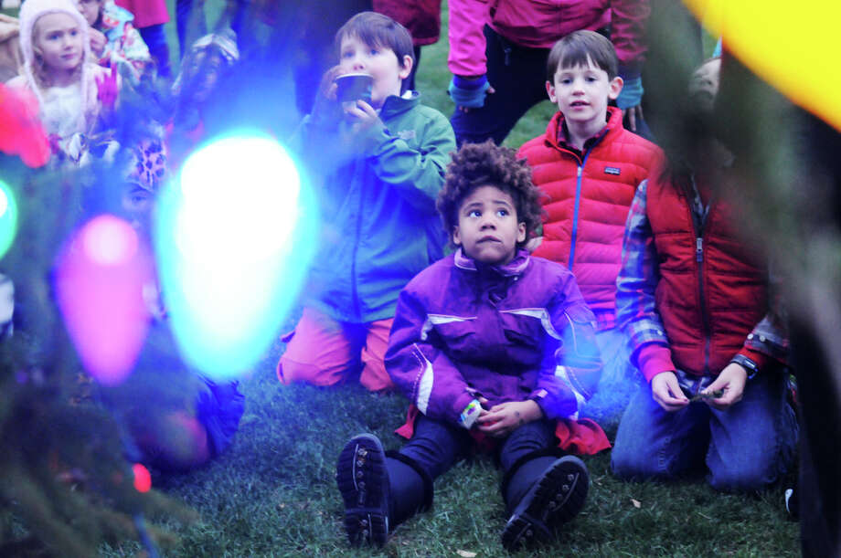 Lily Smith, center, joins a slew of kids from the community who gathered as the Department of Parks and Recreation hosts its annual tree lighting ceremony at the Town Hall in Greenwich, Conn., Dec. 2, 2013.  Santa Claus, Rudolph and Frosty the Snowman made the scene. Photo: Keelin Daly / Stamford Advocate Freelance