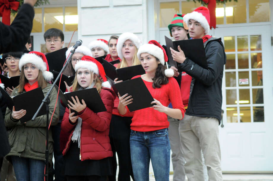 The Greenwich High School Chamber Singers open the ceremony as the Department of Parks and Recreation hosts its annual tree lighting ceremony at the Town Hall in Greenwich, Conn., Dec. 2, 2013.  Santa Claus, Rudolph and Frosty the Snowman made the scene. Photo: Keelin Daly / Stamford Advocate Freelance