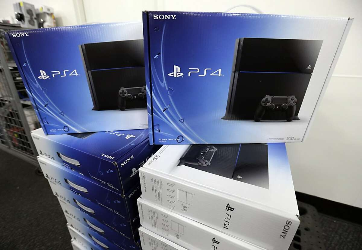 FILE - In this Friday, Nov. 15, 2013 file photo, the new Sony Playstation 4 is on display at Lincoln Park BestBuy store, in Chicago. There's a couple of new foes affecting gamers who are proving to be far more destructive than any on-screen villains. With foreboding nicknames like