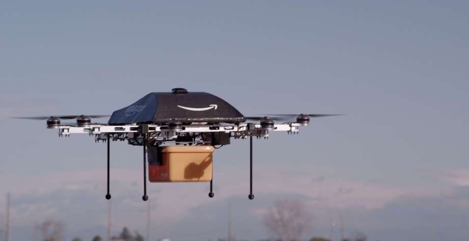 UNSPECIFIED DATE AND LOCATION:  (NO SALES; NO ARCHIVE) In this handout provided by Amazon.com, a remote aerial vehicle being called Prime Air that online retailer Amazon hopes to develop to deliver goods to customers takes flight. Amazon CEO Jeff Bezos hopes to deliver packages to customers in 30 minutes or less using the unmanned vehicles but says it could take years to advance the technology and get FAA approval. (Photo by Amazon via Getty Images) Photo: Handout / 2013 Amazon