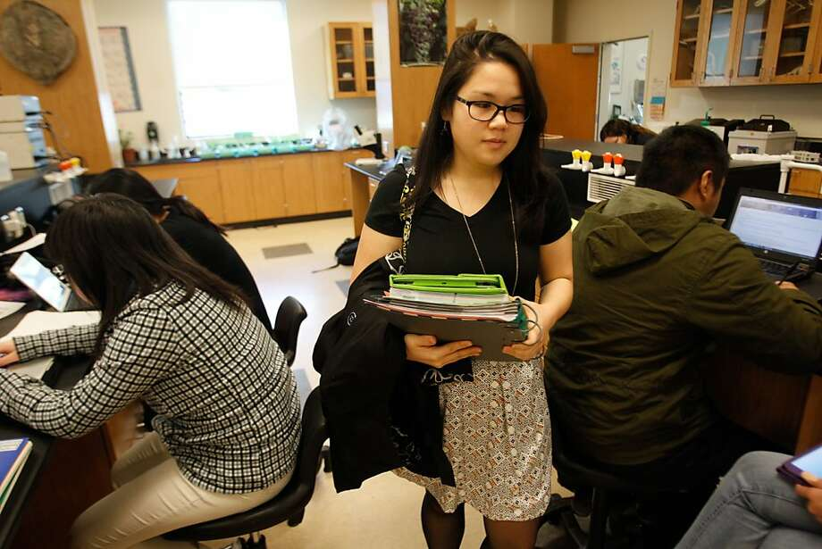 Deanna Badong, at Skyline College's biology lab, is healthy now and free of binging, purging or starving behaviors. Photo: Mathew Sumner, Special To The Chronicle