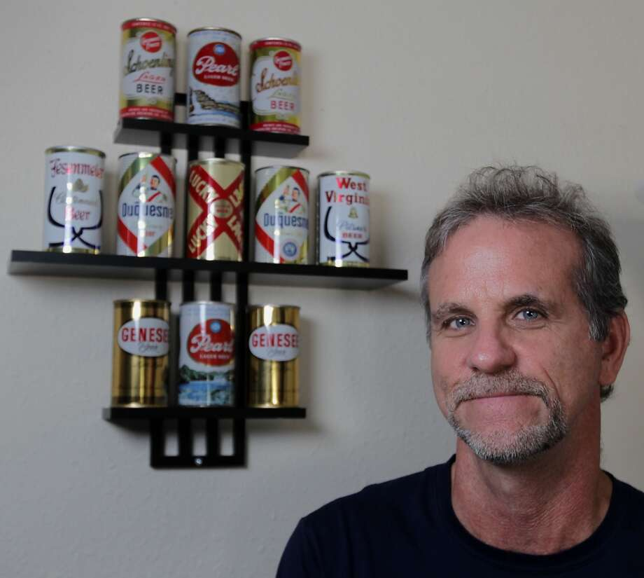 Ken Knisely poses for a portrait with part of his beer can and beer memorabilia collection Wednesday, Nov. 27, 2013, in Houston.  ( James Nielsen / Houston Chronicle ) Photo: James Nielsen, Houston Chronicle
