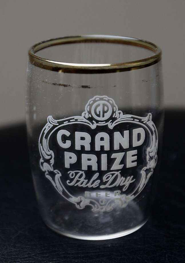 A Grand Prize beer company glass which is part of Ken Knisely's beer can and beer memorabilia collection Wednesday, Nov. 27, 2013, in Houston.  ( James Nielsen / Houston Chronicle ) Photo: James Nielsen, Houston Chronicle