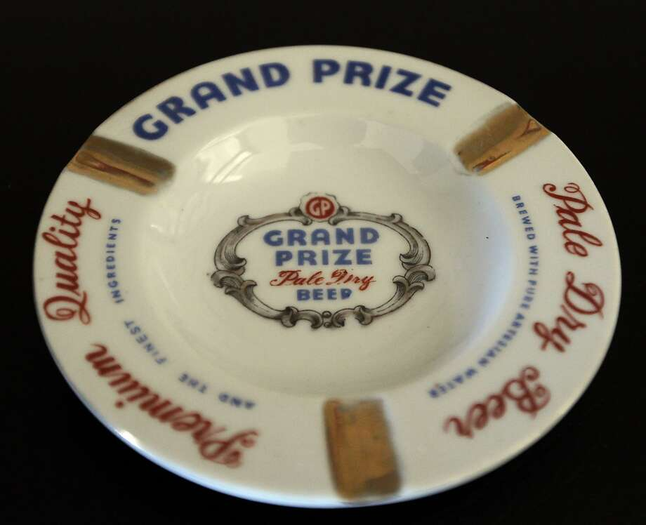 A Grand Prize beer company ashtray which is part of Ken Knisely's beer can and beer memorabilia collection Wednesday, Nov. 27, 2013, in Houston.  ( James Nielsen / Houston Chronicle ) Photo: James Nielsen, Houston Chronicle