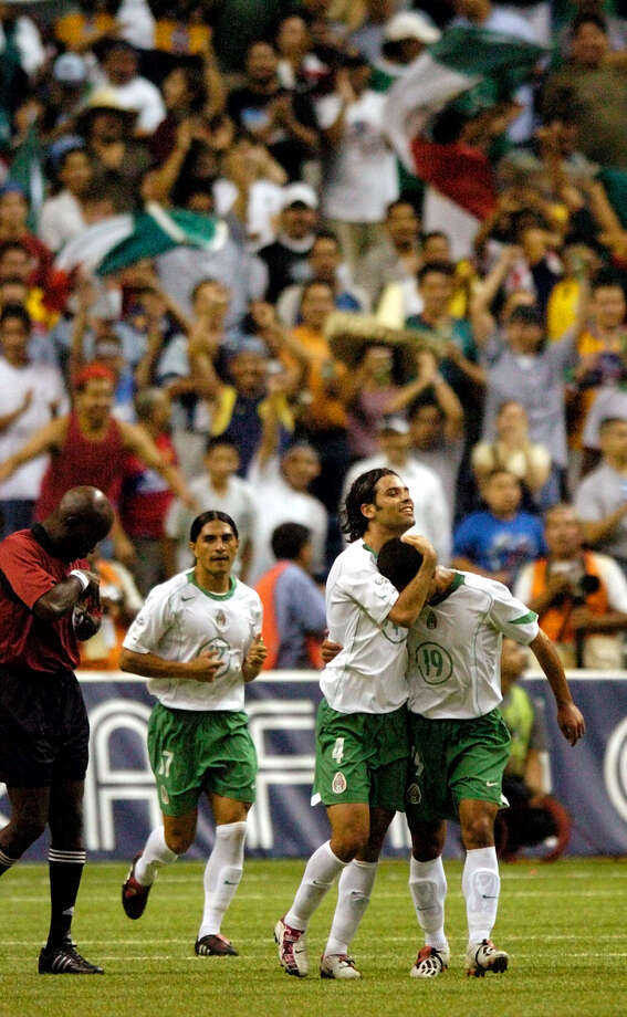 Mexican team members celebrate in the second half of their most-recent game at the Alamodome in 2004. Photo: San Antonio Express-News