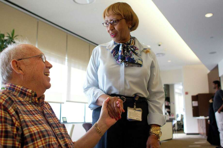 Ola Doureseau, 70, a patient navigator at Houston Methodist Cancer Center, checks on patient Jim Ott Wednesday, Sept. 18, 2013, in Houston. Doureseau greets all the cancer patients as they come for cancer outpatient treatments. She knows almost all of their names and treats them like guests in her home. Photo: Johnny Hanson, Houston Chronicle / Houston Chronicle