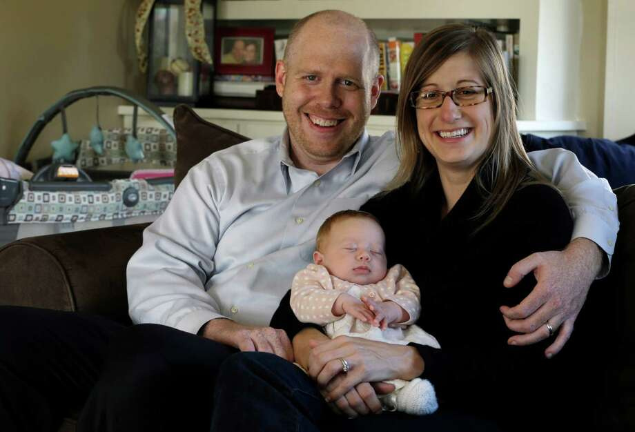 Ken and Abigail Ernst of Oldwick, N.J., conceived their now 2-month-old daughter, Lucy, by using only one embryo through in vitro fertilization. Photo: Julio Cortez, STF / AP