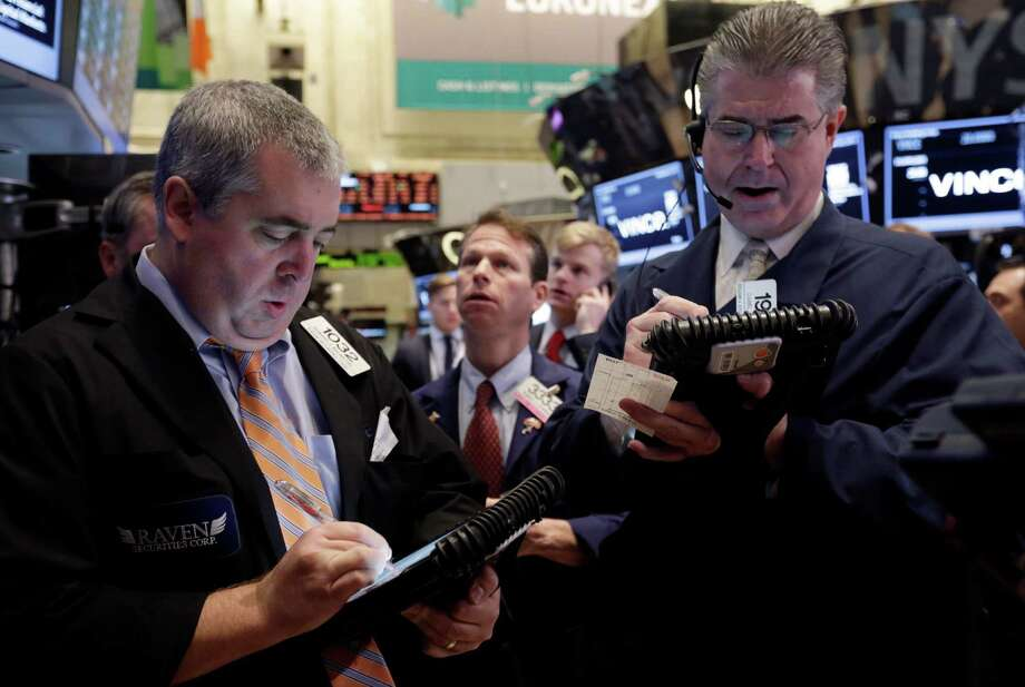 Traders work on the floor of the New York Stock Exchange. (AP Photo/Richard Drew, File) Photo: Richard Drew / AP