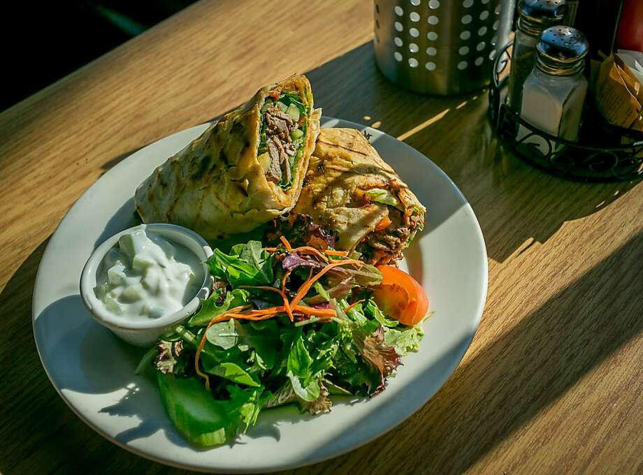 Above, the shawerma ($14) is served with tahini sauce and a homemade bell pepper and eggplant spread and comes with a mixed green salad. Left, families are part of the daytime crowd. Below, silver dollar pancakes ($7.25 half stack, $10.25 full). Photo: John Storey, Special To The Chronicle