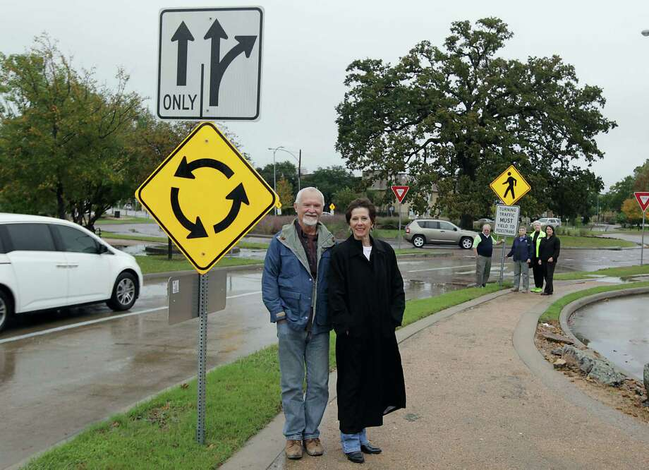 WOW Roundabout Initiative VP Tom Dornbush, left, WOW President Phyllis Thomason and other members visit the Washington and Wescot roundabout. Photo: James Nielsen, Staff / © 2013  Houston Chronicle