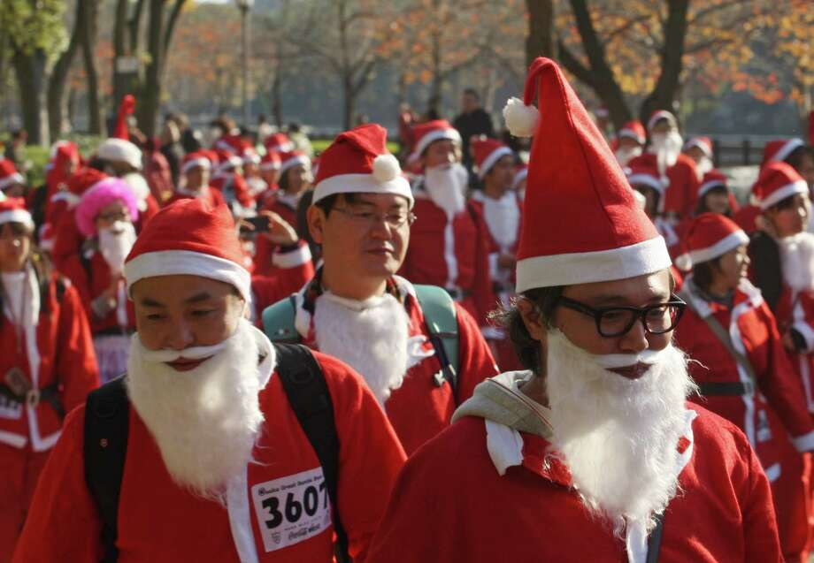 Participants dressed as Santa Claus run 5th annual Osaka Great Santas Run at fornt of the Osaka Castle on December 1, 2013 in Osaka, Japan. Participation fees will be donated to children who have to spend Christmas day in a hospital. Photo: Buddhika Weerasinghe, Getty Images / 2013 Getty Images