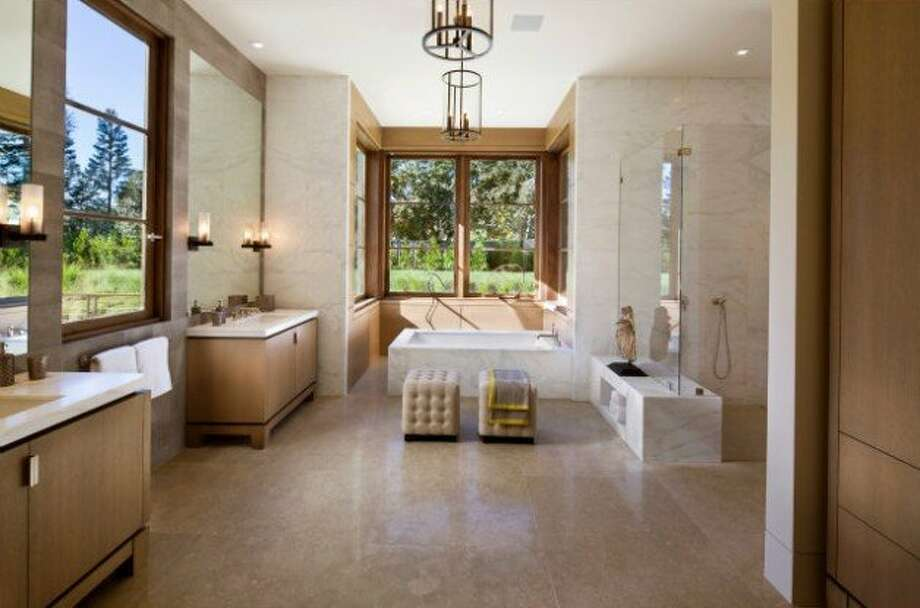Bathrooms that go on for days. Photos via Trulia and Pacific Peninsula Group.