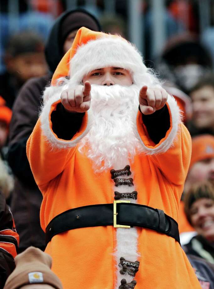 A Cleveland Browns fan dresses as Santa Claus cheers in the first quarter of an NFL football game against the Jacksonville Jaguars Sunday, Dec. 1, 2013, in Cleveland. Photo: Tony Dejak, Associated Press / AP