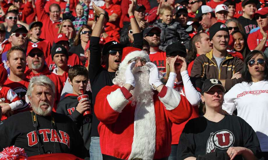 A Utah fan dressed as Santa Claus shows his support in the first half during an NCAA college football game against Colorado Saturday, Nov. 30, 2013, in Salt Lake City. Photo: Rick Bowmer, Associated Press / AP