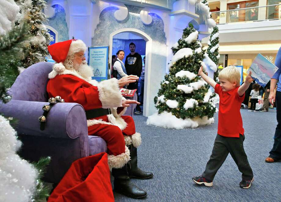 John Doris, 4, stretches out his arms to hug Santa Claus, at the Ice Palace inside Cherry Creek Mall, in Denver, Friday, Nov. 29, 2013. Black Friday, the day after Thanksgiving, is the nation's biggest shopping day of the year. Photo: Brennan Linsley, Associated Press / AP