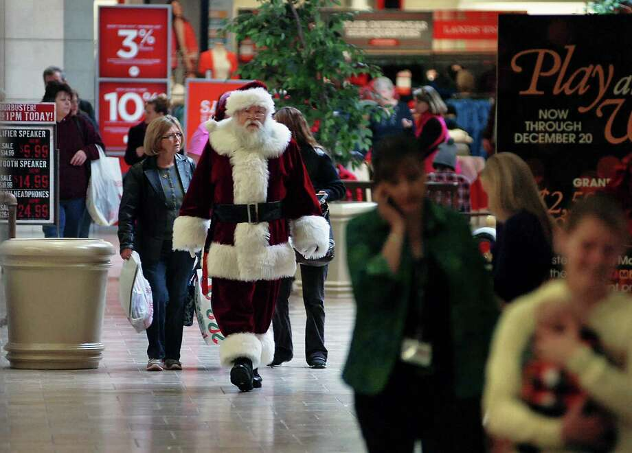 Santa Claus makes walks to his greeting platform at the Viewmont Mall on Friday, Nov. 29, 2013, in Dickson City, Pa. Photo: Butch Comegys, Associated Press / The Scranton Times & Tribune