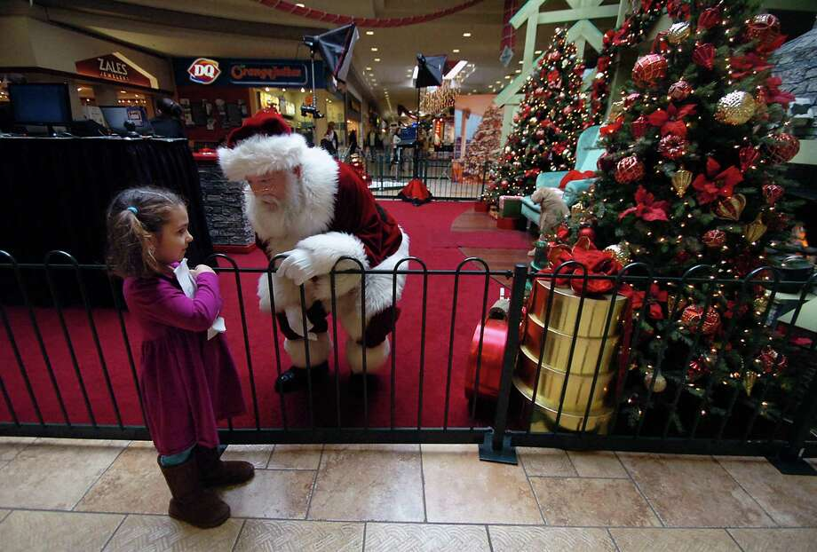 Santa Claus greets Addyson Grant, 5, of Rocky Hill, Conn., as she holds her Christmas book that she made at the Viewmont Mall on Friday, Nov. 29, 2013, in Dickson City, Pa. Photo: Butch Comegys, Associated Press / The Scranton Times & Tribune