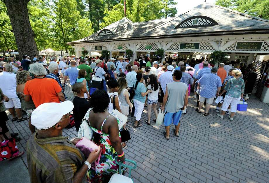 A  large crowd on queue at the grandstand gate on opening day of the 143rd race meeting at the Saratoga Race Course in Saratoga springs, N.Y. July 22, 2011.    (Skip Dickstein / Times Union) Photo: SKIP DICKSTEIN / 00013986A