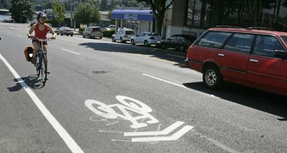 "Q: Can a bicyclist get a ticket for not signaling?  A: Seattle Police Detective Jeff Kappel says, in a word, ""Yes.""  According to Seattle city law, a cyclist must signal when intending to turn, stop or slow down. The signal must be given at least 100 feet before the action is executed.  A ticket would cost a cyclist $103. Photo: Seattlepi.com File"