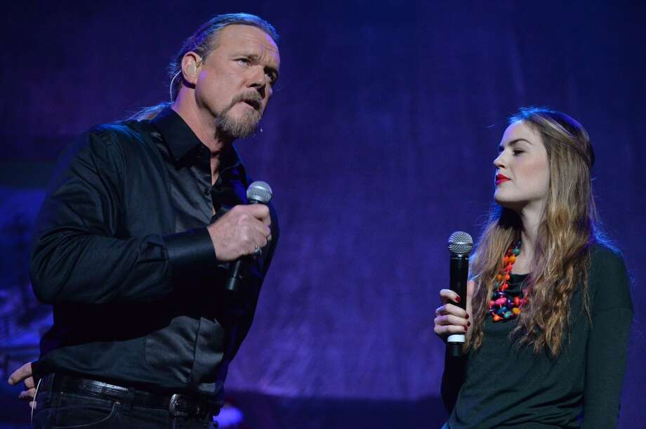 The lady to the right of singer Trace Adkins is a Nashville singer-songwriter who sometimes sings with her famous dad (though he's best known for his acting). Photo: Rick Diamond, Getty Images For Trace Adkins