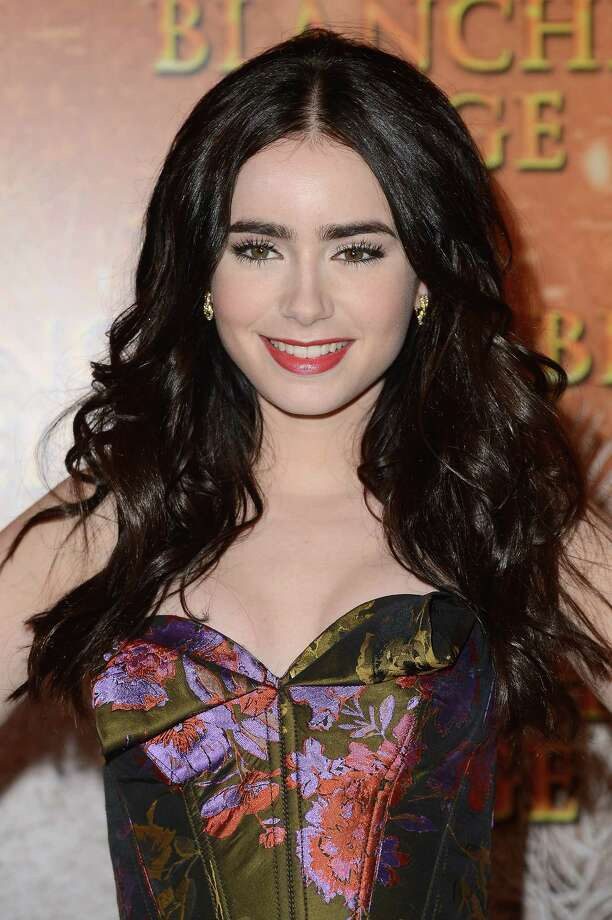 "Actress Lily Collins starred in the Snow White adaptation ""Mirror, Mirror"" with Julia Roberts. Photo: Pascal Le Segretain, Getty Images / 2012 Getty Images"
