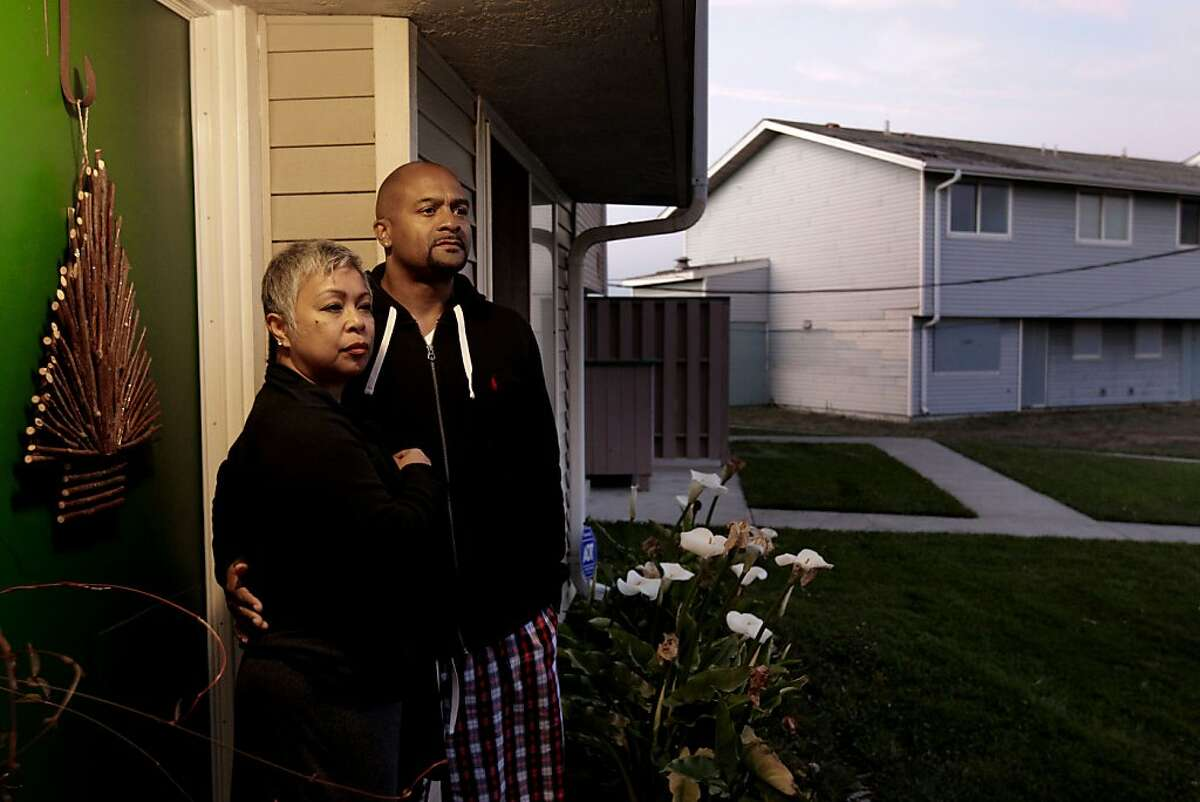 Lucinda and Paris Hayes at the front door of their Treasure Island home in San Francisco, Ca., on Monday Dec. 2, 2013. About 24 households, including that of 10-year Treasure Island residents Paris and Lucinda Hayes, are going to be relocated so that the Navy can do toxic cleanup work in and around the buildings.