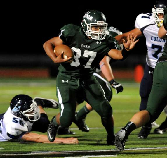 Shenendehowa's Oliver Robinson, center, gains yards during their football game against Columbia on F