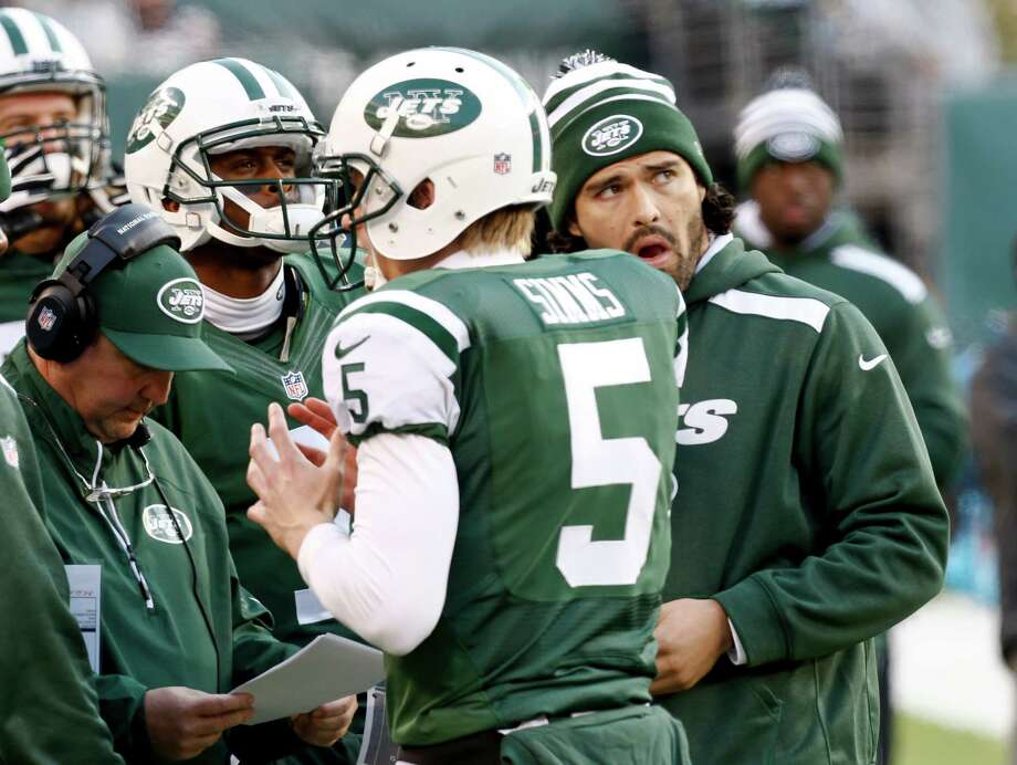 EAST RUTHERFORD, NJ - DECEMBER 1:   Geno Smith #7, Matt Simms #5 and Mark Sanchez #6 of the New York Jets stand with New York Jets offensive coordinator Marty Mornhinweg during their game against the Miami Dolphins at MetLife Stadium on December 1, 2013 in East Rutherford, New Jersey.  (Photo by Jeff Zelevansky/Getty Images) ORG XMIT: 184901141 Photo: Jeff Zelevansky / 2013 Getty Images