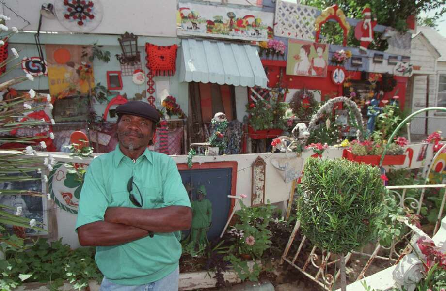 Cleveland Turner, the Flower Man, at his Sampson Street home, the second of three houses where his unique art - a testament of his faith - flourished. Photo: Camilla McElligott, Staff / Houston Chronicle