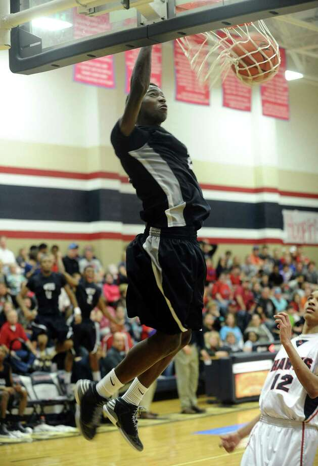 WO-S player Laquarious Paige, #2, dunks the ball for two during the Hardin -Jefferson High School boys basketball game against West Orange-Stark High School on Friday, January 25, 2013, at Hardin-Jefferson High School. H-J won over WO-S 47 - 43. Photo taken: Randy Edwards/The Enterprise Photo: Randy Edwards