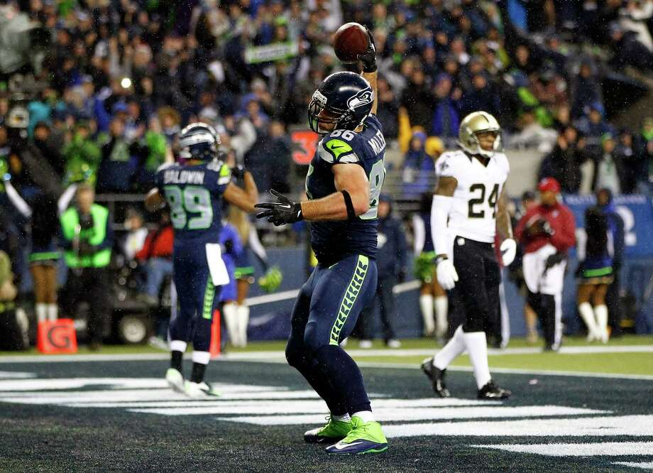 SEATTLE, WA - DECEMBER 02: Tight end Zach Miller #86 of the Seattle Seahawks celebrates a first quarter touchdown against the New Orleans Saints during a game at CenturyLink Field on December 2, 2013 in Seattle, Washington.  (Photo by Jonathan Ferrey/Getty Images) ORG XMIT: 185111048 Photo: Jonathan Ferrey / 2013 Getty Images