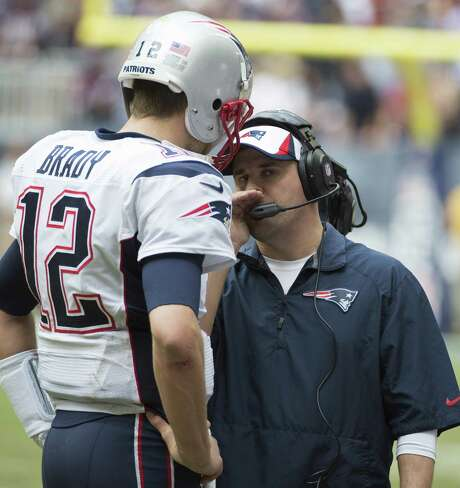 The Patriots might not have been guilty of spying against the Texans, but New England offensive coordinator Josh McDaniels, right, was definitely trying to keep his second-half sideline conversation with quarterback Tom Brady a secret. Photo: George Bridges / MCT
