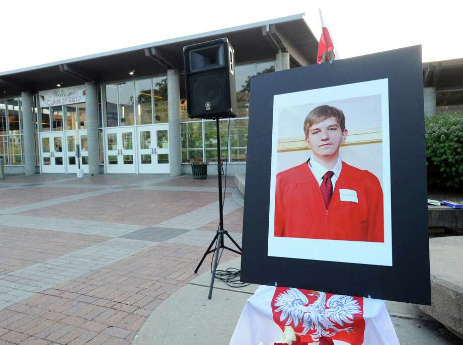 A photograph of Bart Palosz is on display during a Vigil Prayer Service held at Greenwich High School on Sept. 10, 2013. Palosz committed suicide after attending the first day of classes as a sophomore at the high school. The Palosz family said the suicide was the result of school bullying over a period of years. Photo: Bob Luckey / Greenwich Time