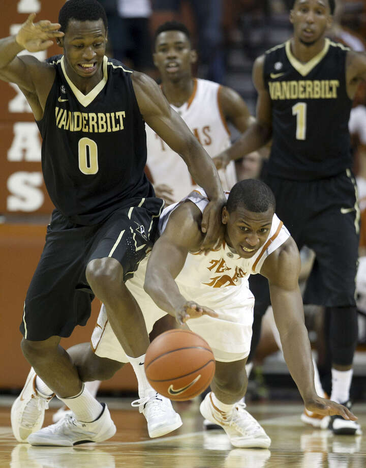 Texas's Jonathan Holmes (right) scrambles for a loose ball in front of Vanderbilt's Rod Odom during the first half. Holmes scored nine points and grabbed seven rebounds, while Odom finished with 11 points and six rebounds. Photo: Deborah Cannon / Austin American-Statesman