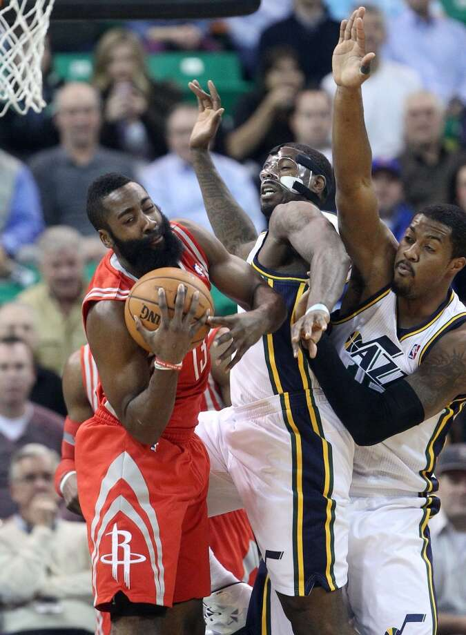 Dec. 2: Jazz 109, Rockets 103  Rockets shooting guard James Harden outrebounds Marvin Williams of the Jazz. Photo: Rick Bowmer, Associated Press