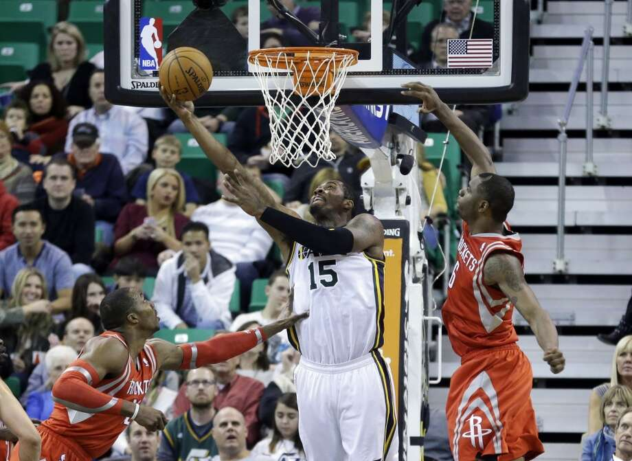 Derrick Favors of the Jazz scores against the Rockets. Photo: Rick Bowmer, Associated Press