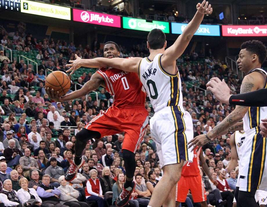 Aaron Brooks of the Rockets tries to make a move against Jazz center Enes Kanter. Photo: Rick Bowmer, Associated Press