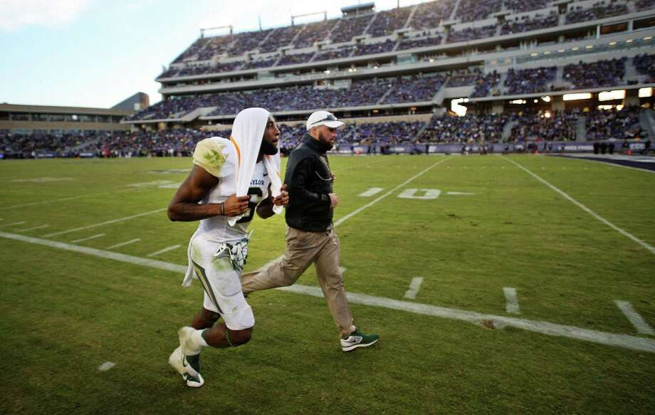 Baylor's Ahmad Dixon, leaving the field after his ejection for a targeting hit against TCU, will miss the first half vs. Texas. Photo: Ron Jenkins / Fort Worth Star-Telegram