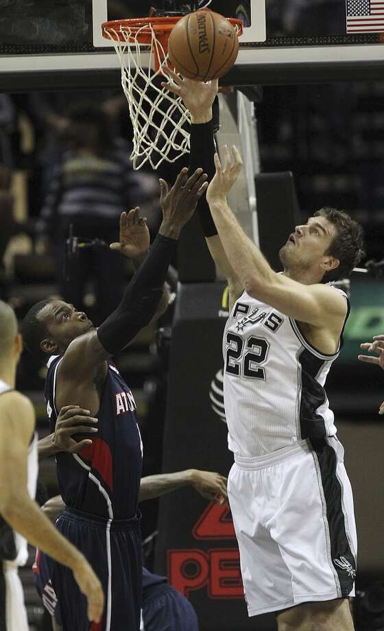 San Antonio Spurs' Tiago Splitter block a shot by Atlanta Hawks' Paul Millsap during the first half at the AT&T Center, Monday, Dec. 2, 2013. Photo: Jerry Lara, San Antonio Express-News